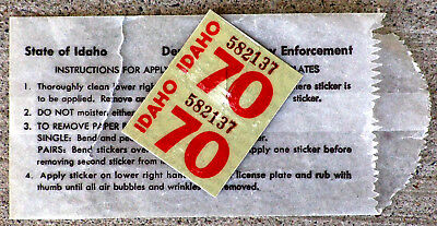 Pair of White 1970 Idaho License Plate Stickers [Note that one is torn]