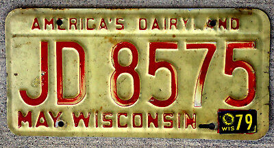 """Red on White Wisconsin """"America's Dairyland"""" License Plate with a 1979 Sticker"""
