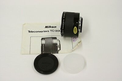 Nikon TC-200 teleconverter with both caps and instructions