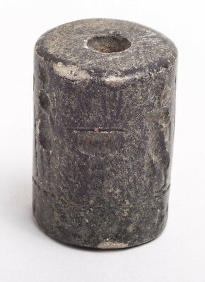 a Massive Near Eastern Style Cylinder Seal with figures and animals. Size 42 x 3