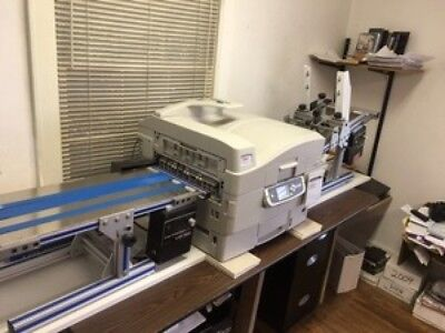 Okidata C 9650 digital color envelope press. Compare Xante Ilumina