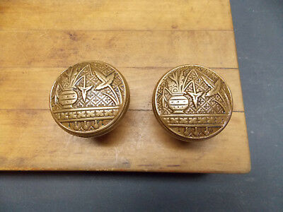 Pair of antique cast bronze door knobs broken leaf pattern