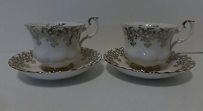 A Pair of Beautiful Silver Anniversary Cups and Saucers by Royal Albert, England