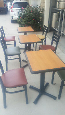Restaurant table and chair sets. Includes 7 tables and 16 leather seated chairs
