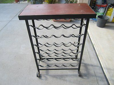 Wine rack holds 30 bottles wood prep bench  top.  black steel. good condion