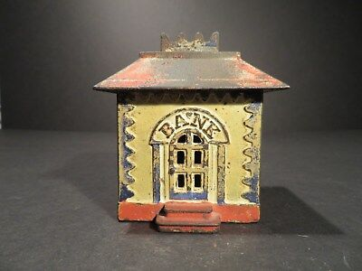 Medium Crown Cast Iron Antique Bank Painted Yellow, Red, & Blue