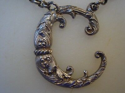 "Fine elaborate Victorian silver ""C"" decanter label. 1858-1859."