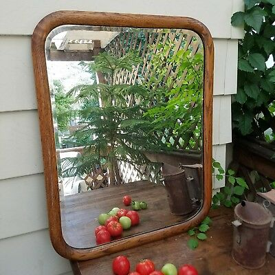 Beautiful large antique beveled glass, oak frame mirror