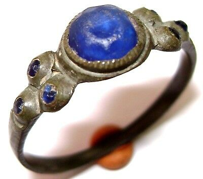 Ancient  BRONZE RING with seven blue stones (gem, glass )
