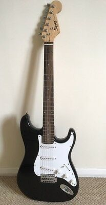 Electric Guitar- Black Squier Strat by Fender and Stagg 10w amplifier