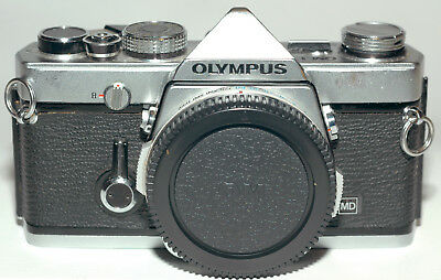 Olympus OM-1 35mm SLR film camera body only. Tested. works perfectly