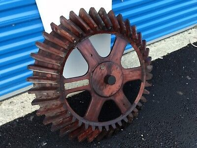 """Large 32"""" diameter old antique wood foundry gear."""