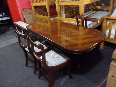 mahogany extending dining table and 4 chairs by strongbow furniture