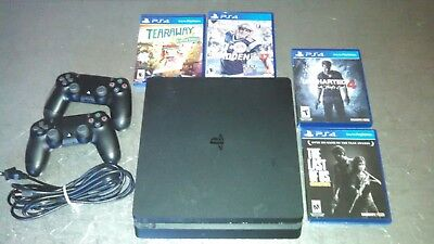 PS4 Sony Playstation 4 500GB SLIM console with 4 games, controller and bag