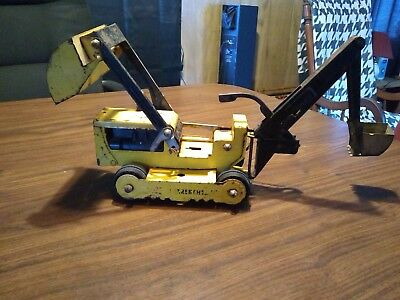 this tonka trencher has been used but this one still has the the backhoe