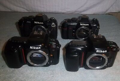 Lot of 4 Nikon 35mm SLR Camera Bodys, 2--N50's N2020, & N2000 AS-IS Unknown Cond