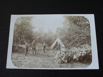 Real Photo postcard of Boy Scouts Camping & Wood Gathering.