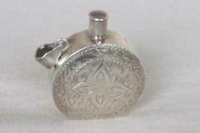An Exquisite Little Sterling Silver Continental Perfume Bottle.
