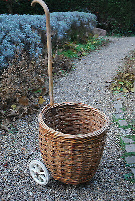 vintage shopping basket on wheels with walking stick handle