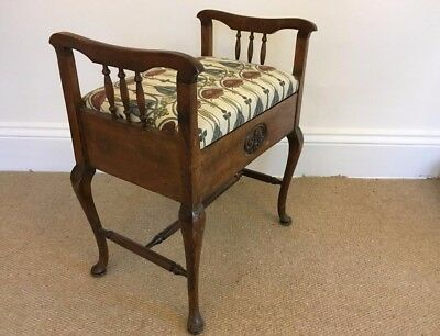 Beautiful carved antique mahogany Piano Stool with newly upholstered seat