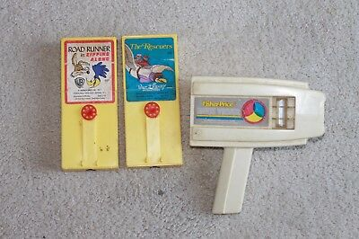fisher price vintage movie viewer with Road Runner and The Rescuers