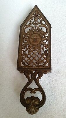 Antique Muster Geschutzt Sunburst face German Cast Iron Trivet