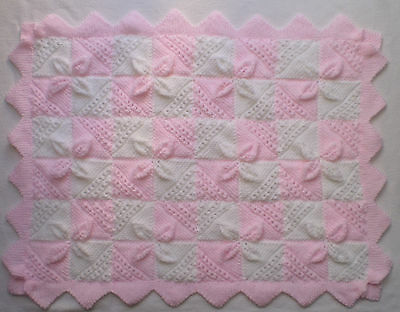 Beautiful hand knitted pink and white pram/cot blanket