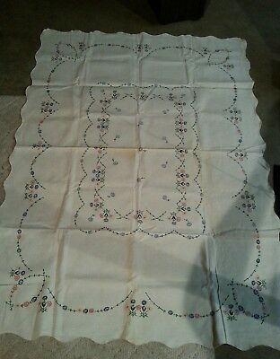 vintage ivory color tablecloth with floral decorations