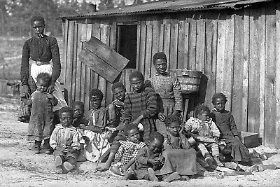 1906-African American Group of Twelve Children and a Woman in Front of a Shack