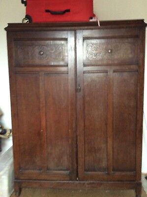 Antique wardrobe, with lovely detail on the doors.