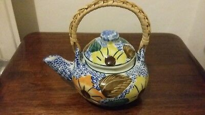 Japanese / Chinese teapot with bamboo handle.