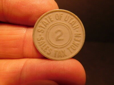 "Vintage grey plastic UTAH State Sales Tax Token ""2"""