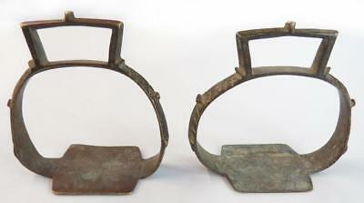 A PAIR OF 19th century INDIAN STIRRUPS Of characteristic form, cast in brass