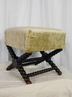 A Large Antique Bobbin Base Foot Stool With Wool Work Top