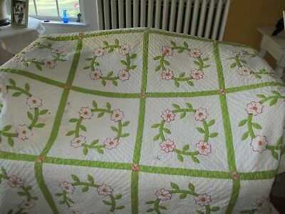 Antique hand quilted quilt. Green & Pink on white squares. Condition issues.