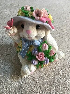 Rabbit with Hat and Basket of flowers.  Resin Figurine