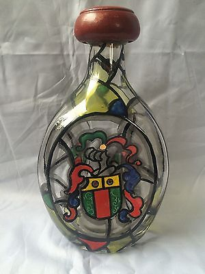 antique glass bottle with arms of coat.