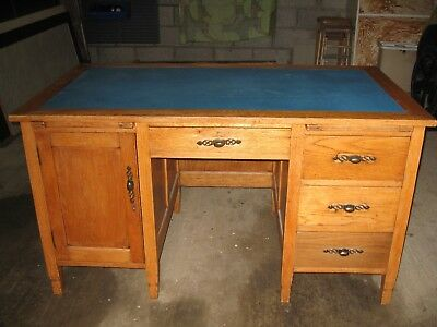 Solid Oak Writing/Computer/Office Desk with extension leaves and leather top.