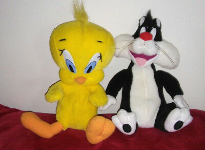 RARE and Hard To Find Vintage Interactive Tweety Bird & Sylvester plush toys.