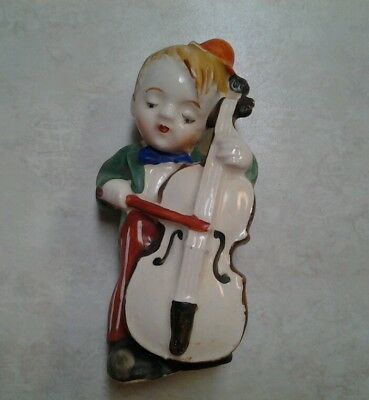 Vintage Made in occupied Japan porcelain  boy playing bass figurine