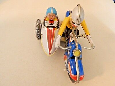 Tin Wind-Up Motorcycle W/ Sidecar Nice Condition..rubber Head On Girl In Sidecar
