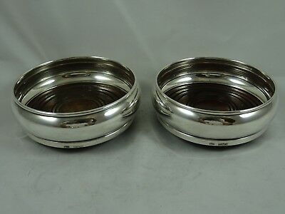 PAIR, solid silver WINE BOTTLE COASTERS, 1984