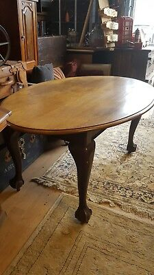 oak dining table/ ball and claw feet sits 6