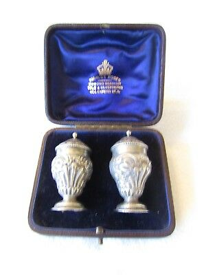 Cased Pair of  Early Victorian Pepperettes in solid silver by Henry Wilkinson