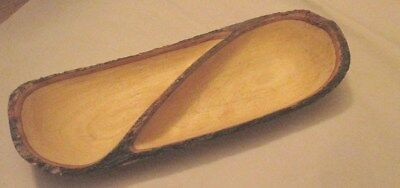 "Carved out wooden bowl with divider.Made from a single piece of wood. 17""L x 6""W"