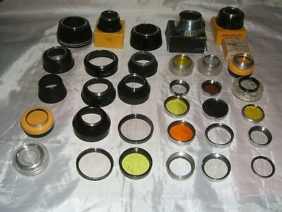 Collection Of Vintage Lens Filters & Hoods Of Varying Sizes