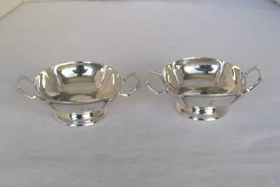 A Superb Pair Of Solid Sterling Silver Twin Handled Edwardian Dishes Dates 1906.