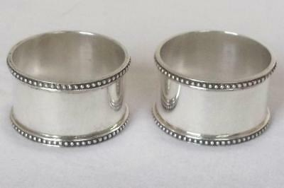 A Lovely Heavy Pair Of Solid Sterling Silver Napkin Rings London 1985.