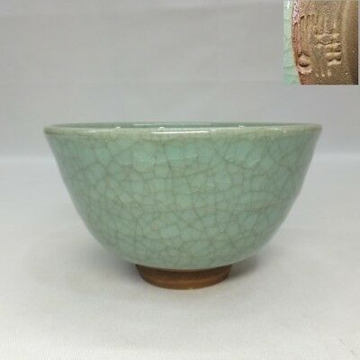 F784: Japanese pottery tea bowl with crackle blue glaze of good tone w/sign