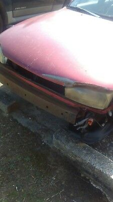 1994 Toyota Camry  1994 Toyota Camry LE 2.2l 4 cyl. Minor accident report - Missing front bumper